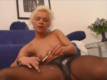 Blonde girl burning holes with cigarette and taking facial