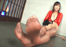 Cute Asian girl does handjob on dildo wearing nylons on hands