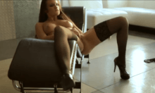 Young lady in black stockings masturbates in a gentle way
