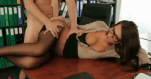 Busty brunette in glasses fucks her colleague in the office
