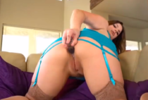 Chubby chick fucks her ass with anal plug