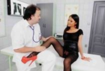 Perverted Asian girl gives footjob to doctor