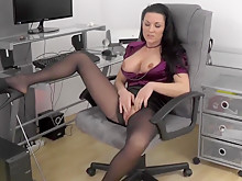 Brunette bitch masturbates at workplace