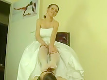 Gorgeous bride makes groom nuzzle her feet